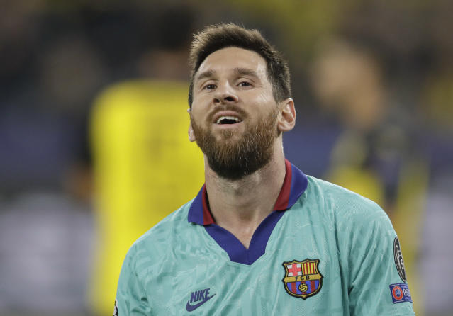 Barcelona's Lionel Messi smiles at the end of the Champions League Group F soccer match between Borussia Dortmund and FC Barcelona in Dortmund, Germany, Tuesday, Sept. 17, 2019. (AP Photo/Michael Probst)