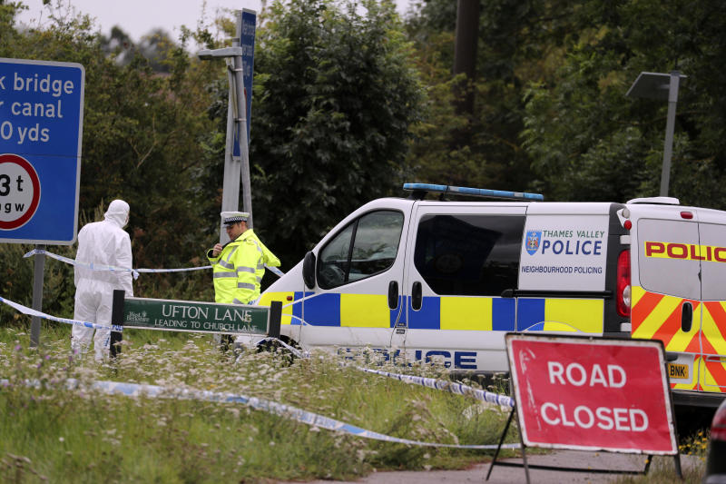 "A police investigator at the scene of an incident where a police officer was killed, near Sulhamstead, England, Friday, Aug. 16, 2019. Thames Valley police say a British police officer investigating a reported burglary has been killed. Ten males have been arrested and are in custody, including a 13-year-old. Authorities say police Constable Andrew Harper of the Roads Policing Proactive unit was killed while ""performing his duties"" on Thursday night near the A4 between Reading and Newbury, in southeast England. (Steve Parsons/PA via AP)"