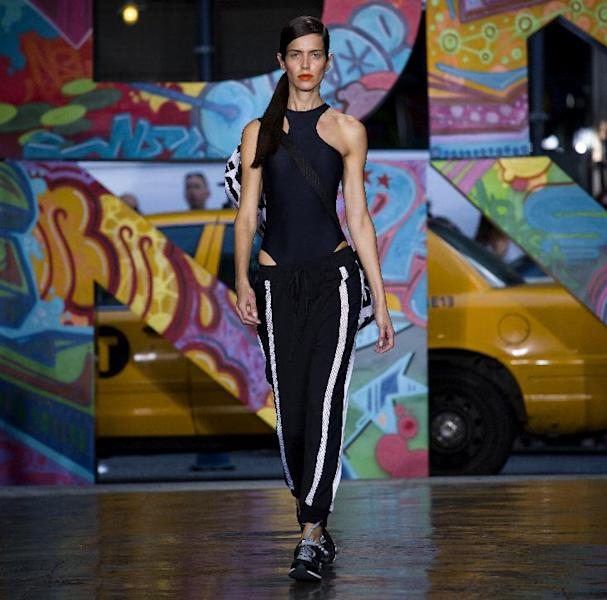 The DKNY Spring 2014 collection is modeled during Fashion Week in New York, Sunday, Sept. 8, 2013. (AP Photo/Craig Ruttle)