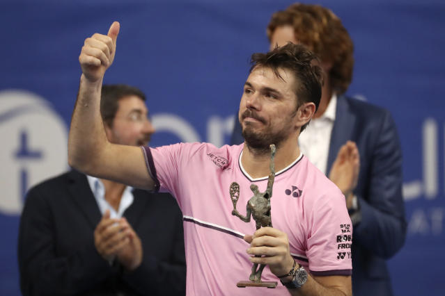 Stan Wawrinka of Switzerland gestures after receiving his second placed trophy at the European Open final tennis match in Antwerp, Belgium, Sunday, Oct. 20, 2019. Andy Murray of Britain defeated Wawrinka 3-6/6-4/6-4. (AP Photo/Francisco Seco)