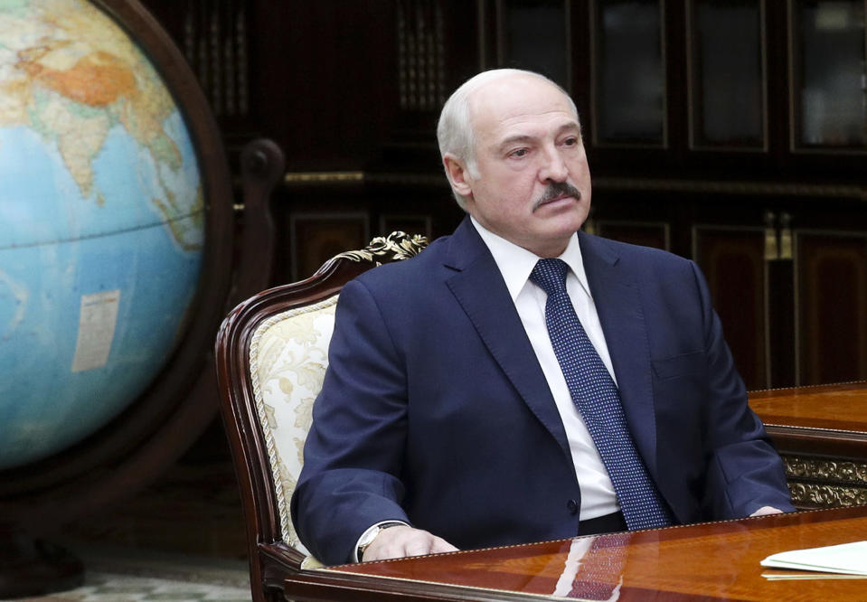FILE - In this Monday, June 1, 2020 file photo, Belarusian President Alexander Lukashenko meets with Valery Vakulchik, chief of the Belarusian state security service, KGB, in Minsk, Belarus. Lukashenko said Friday, June 19, 2020 that his government has thwarted plans to destabilize Belarus ahead of a presidential vote in August, a statement that follows the detention of his top challenger, Viktor Babariko, the former head of Russia-owned Belgazprombank.(Nikolai Petrov/BelTA Pool Photo via AP, File)
