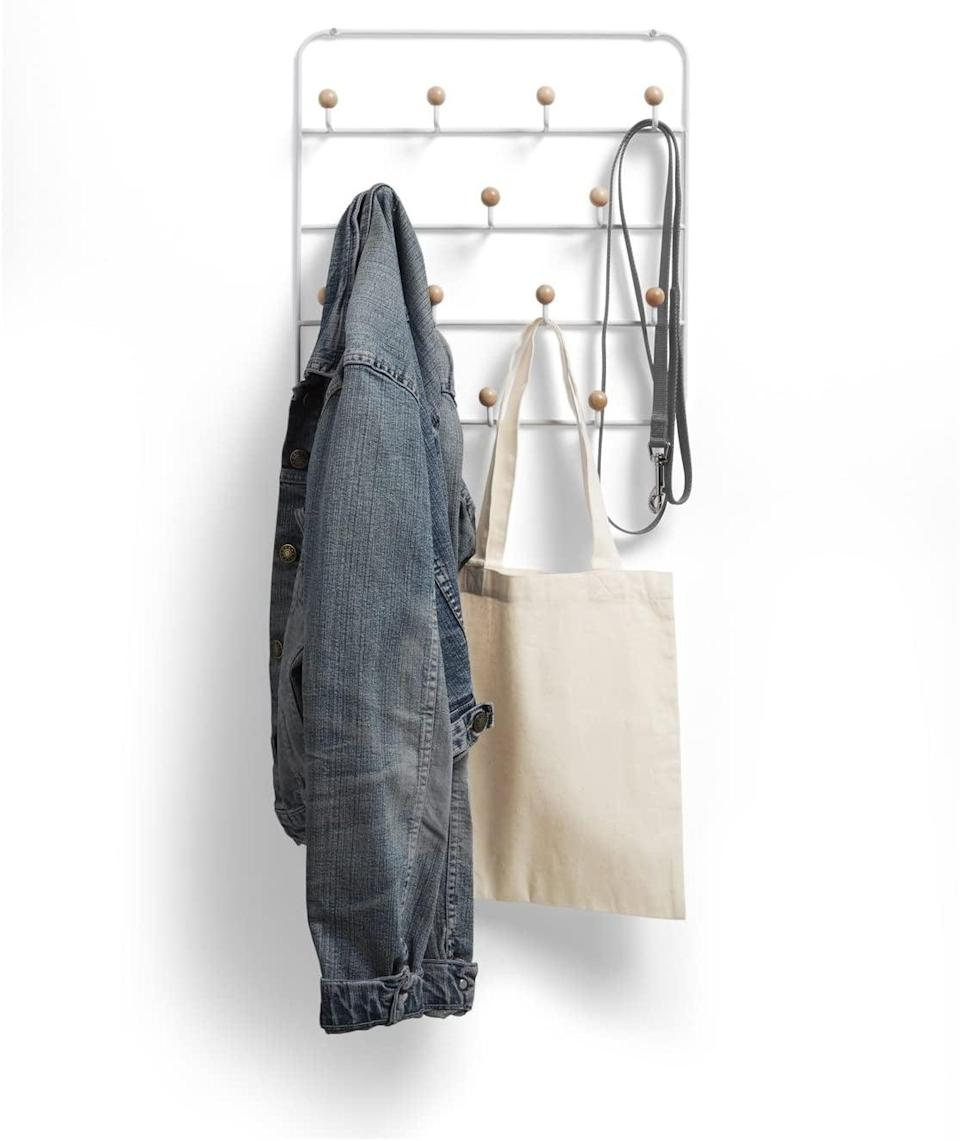 <p>From towels and clothes to bags and umbrellas, you can get so much use out of this <span>Umbra Estique Over-the-Door Organizer</span> ($21). These 14 generously spaced hooks allow room for accessories of all sizes and shapes, giving you the opportunity to make use of every hook.</p>