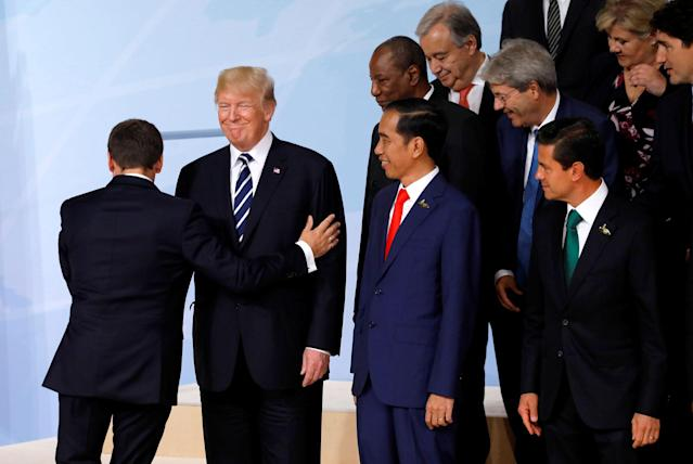 <p>French President Emmanuel Macron passes President Donald Trump at the G20 summit in Hamburg, Germany July 7, 2017. (Photo: Carlos Barria/Reuters) </p>