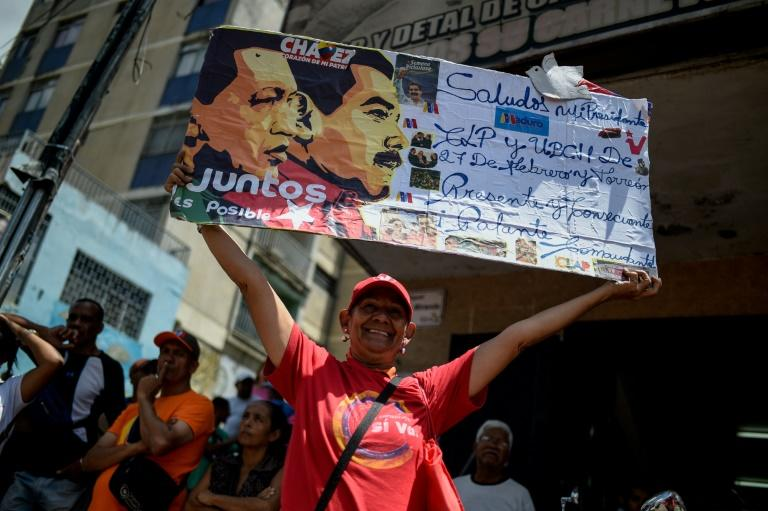 Supporters of Venezuelan President Nicolas Maduro take part in a rally in Caracas on August 13, 2018