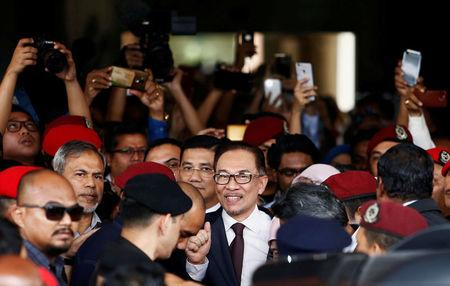 Malaysian politician Anwar Ibrahim leaves a hospital where he is receiving treatment, ahead of an audience with Malaysia's King Sultan Muhammad V, in Kuala Lumpur, Malaysia. REUTERS/Lai Seng Sin