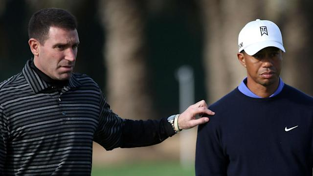 Tiger Woods' agent, Mark Steinberg, threw cold water on a report that his client is unlikely to be healthy enough to play in the Masters.