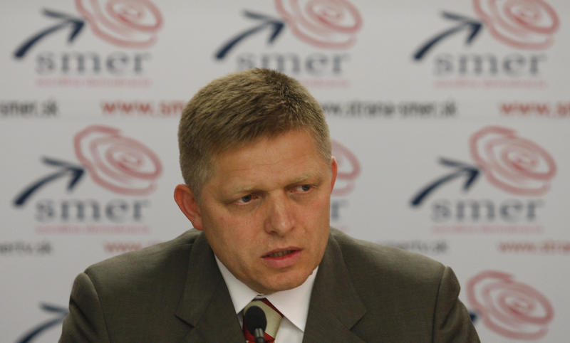 "FILE - This is a Wednesday, Oct. 12, 2011 file photo of Robert Fico chairman of the strongest opposition party SMER-Social Democracy holds a press conference at his party's headquarters in Bratislava, Slovakia. For two years, the dossier claims, politicians of all stripes were pocketing kickbacks from members of an influential private investment group. In the wall of the apartment where the clandestine meetings took place was a listening device planted by a secret agent intrigued by why so many high-level visitors were dropping in. The ""Gorilla"" files _ mysteriously posted online by an anonymous source in December and said to be based on the wiretaps have rocked the already-raucous world of Slovak politics ahead of elections Saturday. The fallout looks certain to propel populist former leader Robert Fico back into power, even though he himself has been implicated. (AP Photo/Petr David Josek, File)"