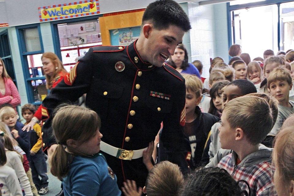 <p>A U.S. marine visits the students who sent care packages to his unit while he was deployed in the Gulf.</p>