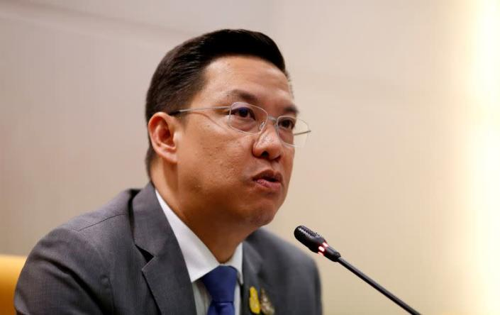 FILE PHOTO: Thailand's minister of Digital Economy and Society Puttipong Punnakanta talks to journalists during the news conference about Facebook and social media in his office in Bangkok