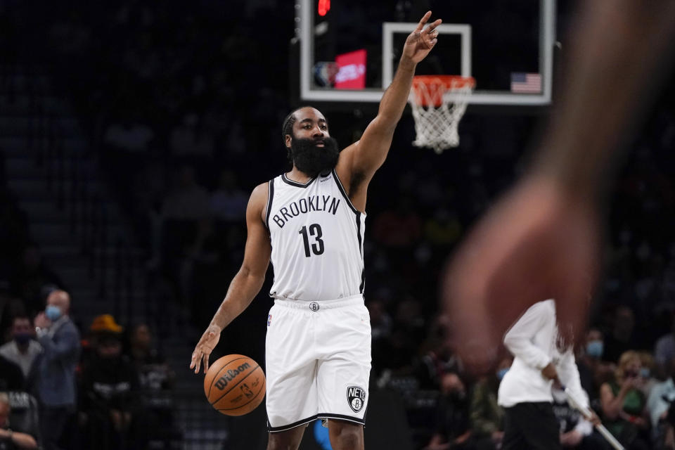 Brooklyn Nets' James Harden calls out to teammates during the first half of a preseason NBA basketball game against the Milwaukee Bucks on Friday, Oct. 8, 2021, in New York. (AP Photo/Frank Franklin II)