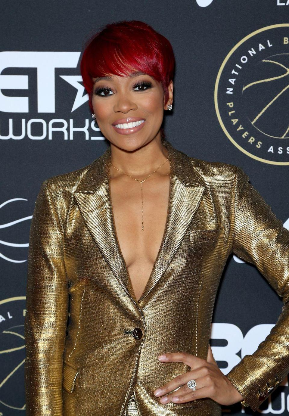 """<p>Singer <strong>Monica Brown</strong> looks striking in this <a href=""""https://www.goodhousekeeping.com/beauty/hair/g2441/red-hair-color-ideas/"""" rel=""""nofollow noopener"""" target=""""_blank"""" data-ylk=""""slk:bright red"""" class=""""link rapid-noclick-resp"""">bright red</a> short bolw haircut with <a href=""""https://www.goodhousekeeping.com/beauty/hair/g34731514/curtain-bangs-ideas/"""" rel=""""nofollow noopener"""" target=""""_blank"""" data-ylk=""""slk:brow-skimming bangs"""" class=""""link rapid-noclick-resp"""">brow-skimming bangs</a>.</p>"""