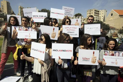 A rally to urge the Lebanese parliament to sign a law against domestic violence, on April 1, 2014, in Beirut