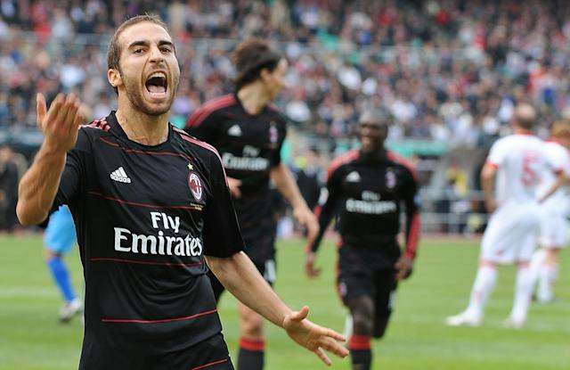 AC Milan's French midfielder Mathieu Flamini (L) celebrates after scoring against Bari during their Italian Serie A football match at Bari's stadium on November 7, 2010. AFP PHOTO / ANDREAS SOLARO (Photo credit should read ANDREAS SOLARO/AFP/Getty Images)