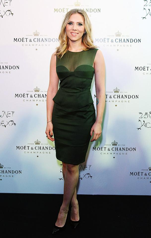 "Speaking of head-turning hotties, take a peek at Scarlett Johansson, who appeared sultry yet chic -- at a Moet & Chandon soiree in Moscow -- in this Army-green Emilio Pucci masterpiece. What do you make of the frock, which featured a sheer yoke, built-in bustier, and flared waist? Hot or not? (10/4/2012) See ScarJo transform into ""Psycho's"" Janet Leigh"