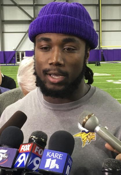 Minnesota Vikings running back Dalvin Cook speaks with reporters Tuesday, April 24, 2018, in Eagan, Minn. Cook is almost seven months out from reconstructive knee surgery, after a torn ACL cut short his promising rookie season. He's on target to be ready for full action in the Vikings' training camp. (AP Photo/Dave Campbell)