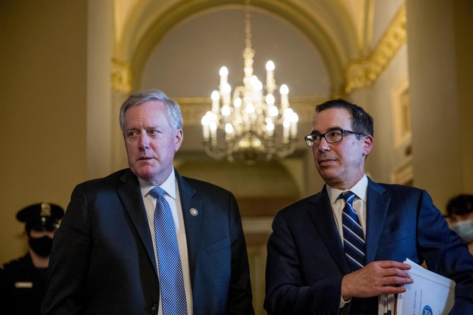 White House chief of staff Mark Meadows, left, accompanied by Treasury Secretary Steven Mnuchin, right, speaks to members of the media following a meeting with Senate Majority Leader Mitch McConnell of Ky. as negotiations continue with Senate Minority Leader Sen. Chuck Schumer of N.Y. and House Speaker Nancy Pelosi of Calif. on a coronavirus relief package on Capitol Hill in Washington, Tuesday, Aug. 4, 2020. (AP Photo/Andrew Harnik)