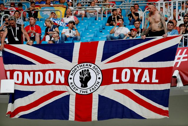 Soccer Football - World Cup - Group G - Tunisia vs England - Volgograd Arena, Volgograd, Russia - June 18, 2018 England fans display a flag inside the stadium before the match REUTERS/Toru Hanai