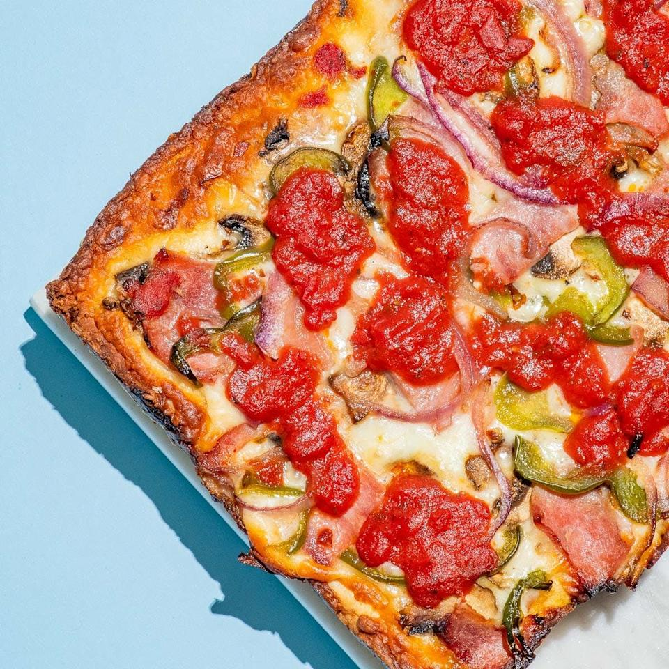 """<p><a href=""""https://www.popsugar.com/buy/Detroit-Style-Pizza-Co-Detroit-Pizza-576178?p_name=%20Detroit%20Style%20Pizza%20Co%20Detroit%20Pizza&retailer=goldbelly.com&pid=576178&price=85&evar1=yum%3Aus&evar9=47494422&evar98=https%3A%2F%2Fwww.popsugar.com%2Ffood%2Fphoto-gallery%2F47494422%2Fimage%2F47494558%2FDetroit-Style-Pizza-Co-Detroit-Pizza&list1=shopping%2Cpizza%2Cgoldbelly&prop13=api&pdata=1"""" rel=""""nofollow"""" data-shoppable-link=""""1"""" target=""""_blank"""" class=""""ga-track"""" data-ga-category=""""Related"""" data-ga-label=""""https://www.goldbelly.com/detroit-pizza-company/15952-create-your-own-pizza-3-pack?ref=category"""" data-ga-action=""""In-Line Links""""> Detroit Style Pizza Co Detroit Pizza </a> ($85 for three) includes dough that's hand-pressed into well-seasoned, square steel pans, then topped with its signature blend of mozzarella and brick cheeses before being baked in deck ovens.</p>"""