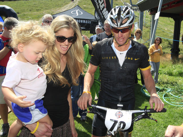 FILE - In this Aug. 25, 2012 file photo, Lance Armstrong, right, jokes with his girlfriend, Anna Hansen, center, and their daughter, Olivia, after his second-place finish in the Power of Four mountain bicycle race at the base of Aspen Mountain in Aspen, Colo. Nike Inc. is cutting ties with the Livestrong cancer charity founded by Armstrong. The move by the sports company is the latest fallout in the doping scandal surrounding the former cyclist, who now admits he used performance-enhancing drugs to win the Tour de France seven times. (AP Photo/David Zalubowski, File)
