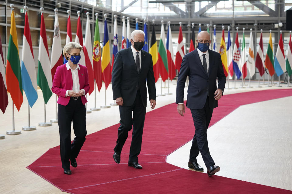 President Joe Biden, center, walks with European Council President Charles Michel, right, and European Commission President Ursula von der Leyen during the United States-European Union Summit at the European Council in Brussels, Tuesday, June 15, 2021. (AP Photo/Patrick Semansky)