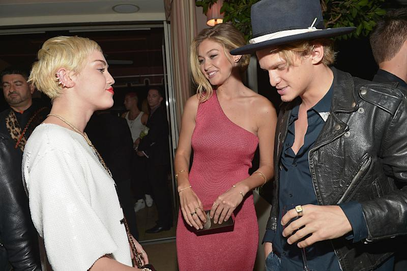 Miley Cyrus, left, talks to model Gigi Hadid and Cody Simpson at the Fashion Los Angeles Awards Show at Sunset Tower on Jan. 22, 2015, in West Hollywood, Calif. (Photo by Charley Gallay/Getty Images for the DAILY FRONT ROW)