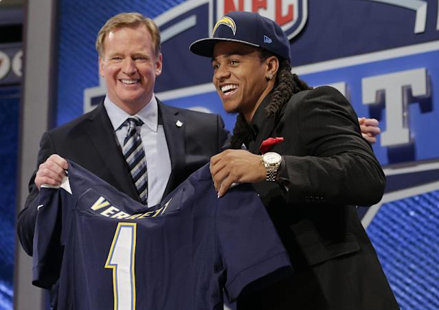 Texas Christian cornerback Jason Verrett reacts with NFL commissioner Roger Goodell after being selected by the San Diego Chargers as the 25th pick of the first round of the 2014 NFL Draft, Thursday, May 8, 2014, in New York. (AP Photo/Craig Ruttle)