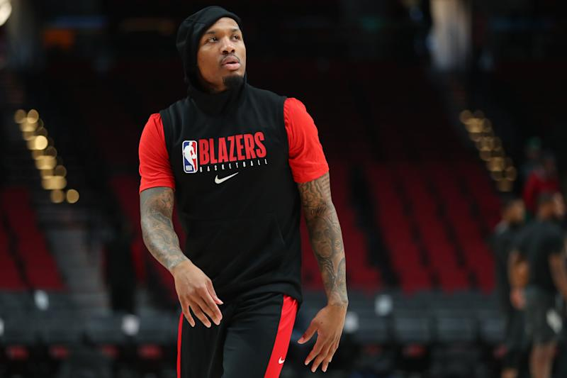 PORTLAND, OREGON - FEBRUARY 25: Damian Lillard #0 of the Portland Trail Blazers warms up prior to their game against the Boston Celtics at Moda Center on February 25, 2020 in Portland, Oregon. NOTE TO USER: User expressly acknowledges and agrees that, by downloading and or using this photograph, User is consenting to the terms and conditions of the Getty Images License Agreement. (Photo by Abbie Parr/Getty Images)