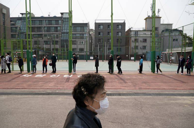 FILE PHOTO: People vote in South Korea's parliamentary election amid the coronavirus disease (COVID19) pandemic