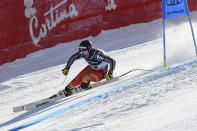Canada's James Crawford speeds down the course during the super G portion of the men's combined race, at the alpine ski World Championships, in Cortina d'Ampezzo, Italy, Monday, Feb. 15, 2021. (AP Photo/Marco Tacca)