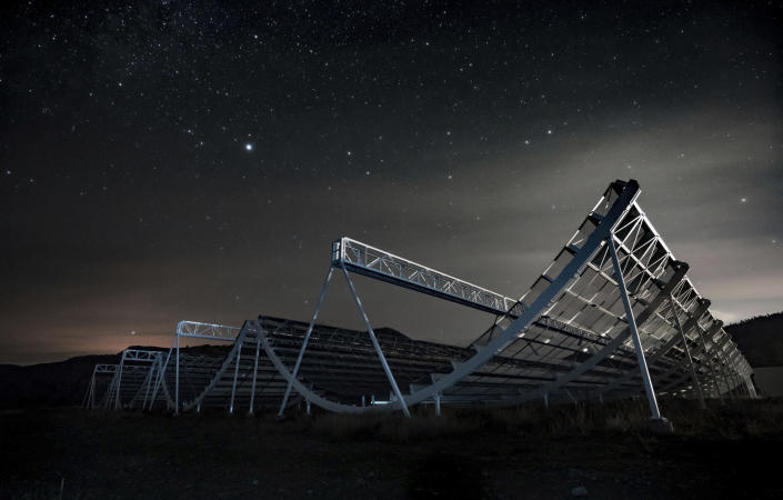 CORRECTS TO NOV. 4 NOT NOV. 5 - This November 2016 photo provided by the Canadian Hydrogen Intensity Mapping Experiment collaboration shows the CHIME radio telescope at the Dominion Radio Astrophysical Observatory in Kaleden, British Columbia, Canada. On Wednesday, Nov. 4, 2020, astronomers say they used the instrument to trace an April 2020 fast cosmic radio burst to our own galaxy and a type of powerful energetic young star called a magnetar. The burst was also detected by a California doctoral student's set of handmade antennas. (Andre Renard/University of Toronto via AP)