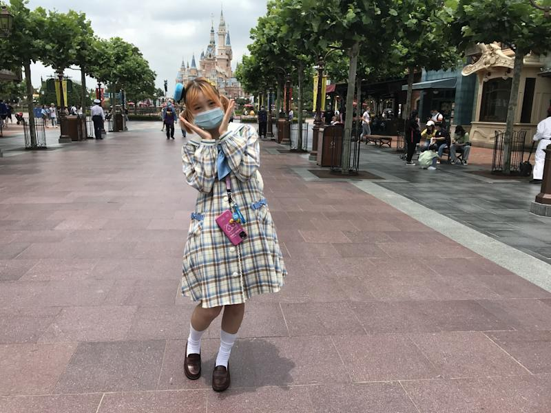 A young visitor expresses glee at Shanghai Disneyland, which is allowing in only 30% of its 80,000-visitor capacity per day.