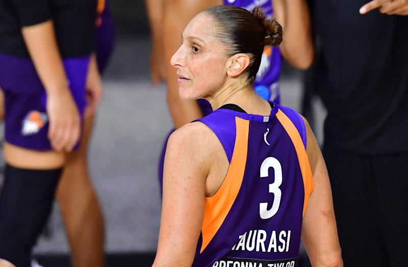 Diana Taurasi in a purple Mercury uniform looks back.