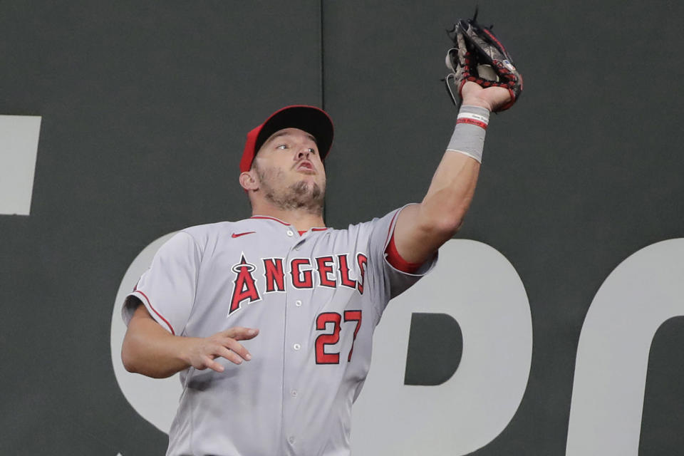 Los Angeles Angels center fielder Mike Trout catches a fly ball hit by Seattle Mariners' Dylan Moore at the wall during the fifth inning of a baseball game Tuesday, Aug. 4, 2020, in Seattle. (AP Photo/Ted S. Warren)