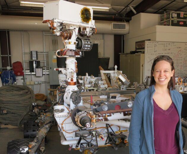 "Melissa Rice, a planetary scientist at Western Washington University, stands alongside a Curiosity testbed rover at the Jet Propulsion Laboratory's ""Mars Yard."" (NASA / JPL Photo via WWU)"
