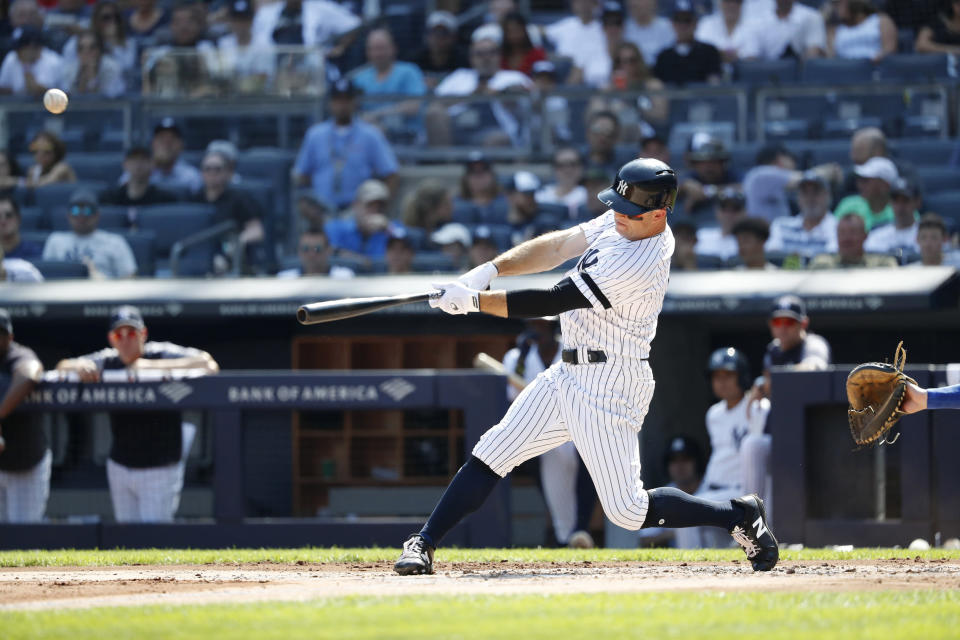 New York Yankees' Brett Gardner hits a three-run home run against the Toronto Blue Jays during the first inning of a baseball game, Sunday, Sept. 22, 2019, in New York. (AP Photo/Michael Owens)