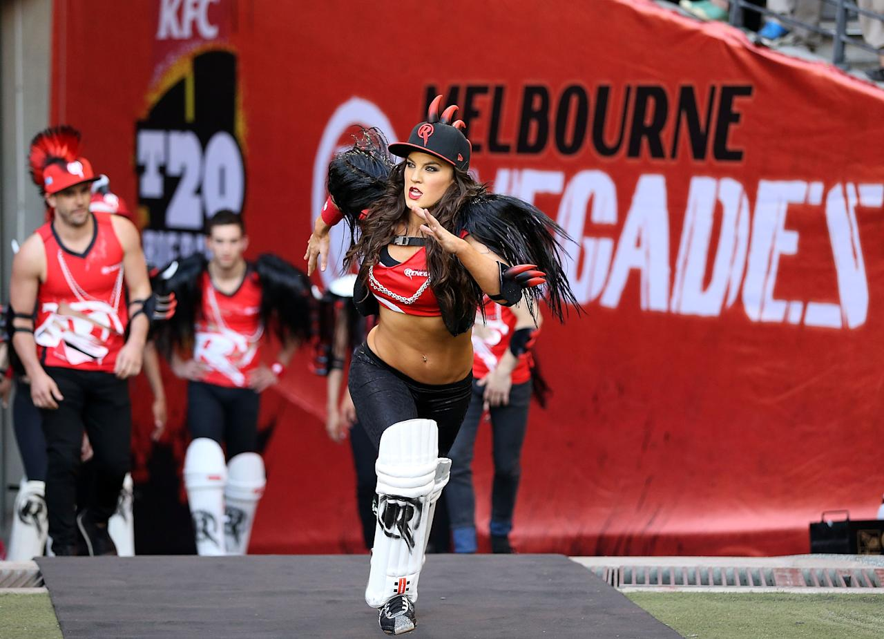 MELBOURNE, AUSTRALIA - DECEMBER 07:  The Renegade dancers run out before the Big Bash League match between the Melbourne Renegades and the Melbourne Stars at Etihad Stadium on December 7, 2012 in Melbourne, Australia.  (Photo by Michael Dodge/Getty Images)