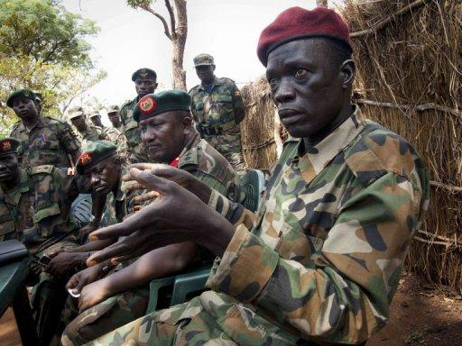 Ceasar Acellam, a senior member of the Lord's Resistance Army, (R) speaks to the press at the Ugandan army base in Djema. Ugandan troops have captured a senior member of the Lord's Resistance Army in a milestone arrest that could signal they are closing in on notorious rebel leader Joseph Kony
