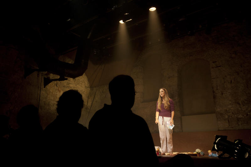 In this photo taken Sunday, July 7, 2013. Israeli actress Sivane Kretchner plays American activist Rachel Corrie as she performs in a theater in Jerusalem. A one-person play about an American activist who was crushed to death by an Israeli military bulldozer is being performed for a Hebrew-speaking audience in Jerusalem. (AP Photo/Sebastian Scheiner)