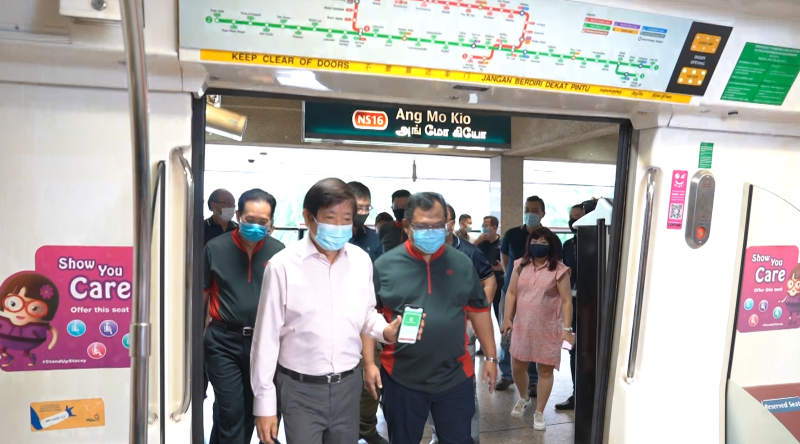 Transport Minister Khaw Boon Wan entering a first generation train at Ang Mo Kio Station on 22 June. (Photo: Nick Tan for Yahoo News Singapore)