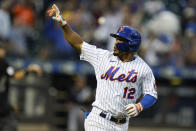 New York Mets' Francisco Lindor (12) gestures to fans as he runs the bases after hitting a two-run home run during the sixth inning in the first baseball game of a doubleheader against the Miami Marlins Tuesday, Sept. 28, 2021, in New York. The Mets won 5-2. (AP Photo/Frank Franklin II)