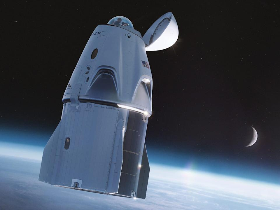 crew dragon spaceship above earth with glass dome cupola beneath nosecone