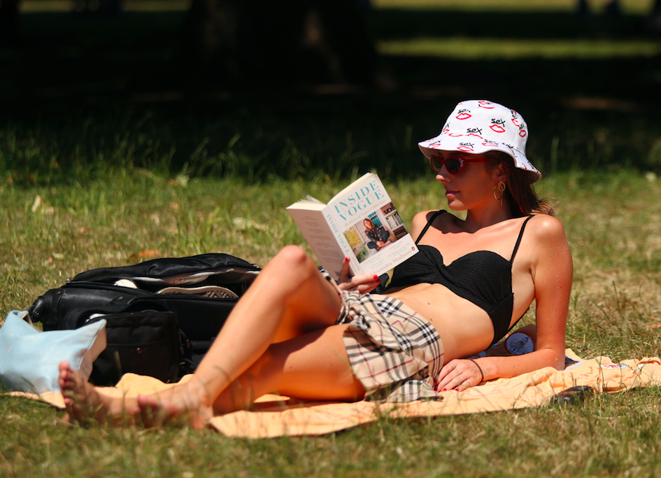 <em>Lottie Edwards lies in the sun in Green Park London, as a heatwave which could produce the hottest temperatures this year is sweeping across the UK (PA)</em>