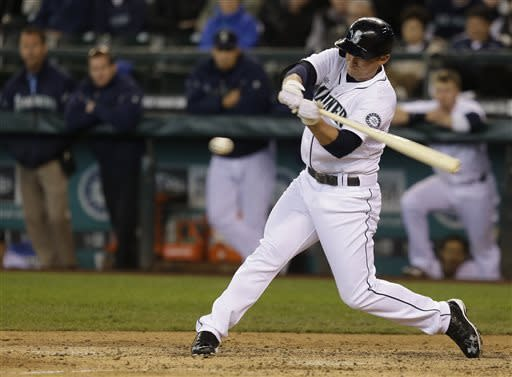 Seattle Mariners' Kyle Seager hits an RBI-double against the Detroit Tigers in the seventh inning of a baseball game on Thursday, April 18, 2013, in Seattle. (AP Photo/Ted S. Warren)
