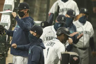 Seattle Mariners' Kyle Lewis (1) is greeted in the dugout after he hit a two-run home run against the Oakland Athletics during the fifth inning of the first baseball game of a doubleheader, Monday, Sept. 14, 2020, in Seattle. (AP Photo/Ted S. Warren)