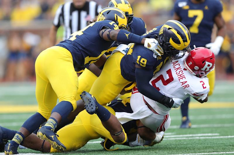 Michigan defensive lineman Kwity Paye tackles Rutgers running back Raheem Blackshear during the second half of U-M's 52-0 win on Saturday, Sept. 28, 2019, at Michigan Stadium.
