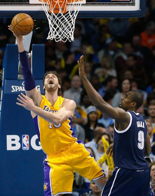 Los Angeles Lakers center Pau Gasol (16) shoots in front of Oklahoma City Thunder forward Serge Ibaka (9) in the third quarter of an NBA basketball game in Oklahoma City, Friday, Dec. 13, 2013. Oklahoma City won 122-97. (AP Photo/Sue Ogrocki)