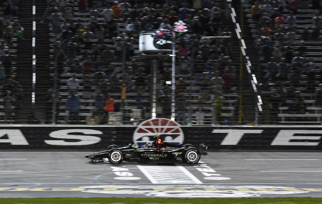 Josef Newgarden takes the checkered flag to win the IndyCar auto race at Texas Motor Speedway, Saturday, June 8, 2019, in Fort Worth, Texas. (AP Photo/Larry Papke)