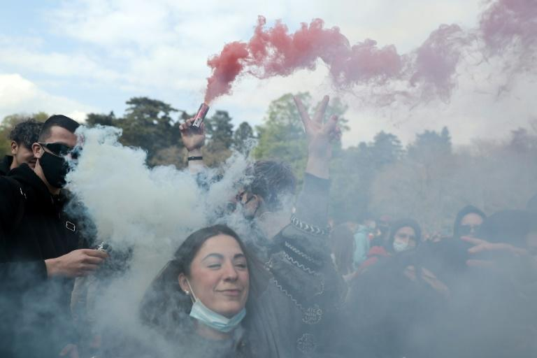Anti-lockdown protesters brandished flares as they faced police in Brussels's Bois de la Cambre park
