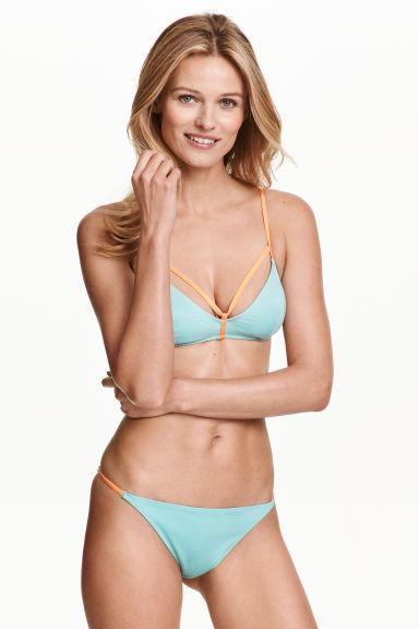 """<p>This apricot and turquoise bikini is our pastel pick this summer. <br></p><p>Buy now<a href=""""http://www2.hm.com/en_gb/productpage.0341902003.html"""" rel=""""nofollow noopener"""" target=""""_blank"""" data-ylk=""""slk:here."""" class=""""link rapid-noclick-resp""""> here. <br></a></p>"""