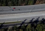 FILE PHOTO: Cars travel on Interstate 405 near Bellevue during the outbreak of coronavirus disease (COVID-19), shown in this aerial photo over Bellevue